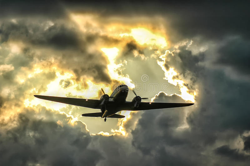 Candy bomber. Douglas DC-3 in the sky over Berlin stock image