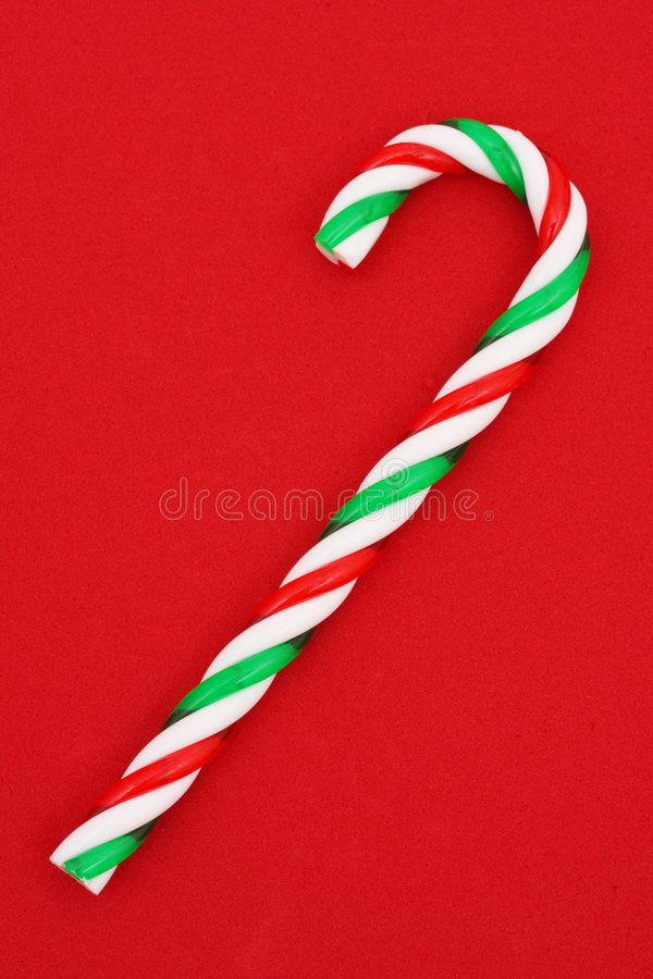 Candy Cane. A green, white and red christmas candy cane royalty free stock photo
