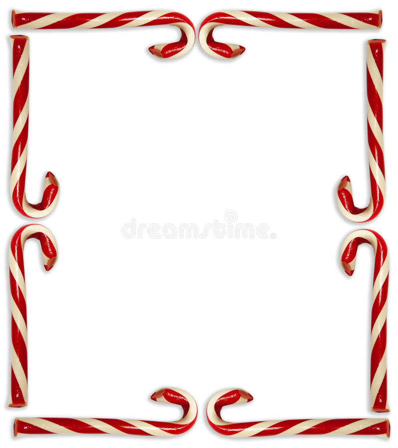 Candy Cane Border. Red and white striped candy canes arranged in border on white background stock photography