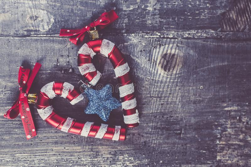 Candy cane Christmas toy with red bow blue Christmas star . cozy Christmas decor . new year 2019.  royalty free stock photos