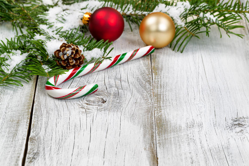 Candy Cane With Snow Covered Fir Branches And Ornaments