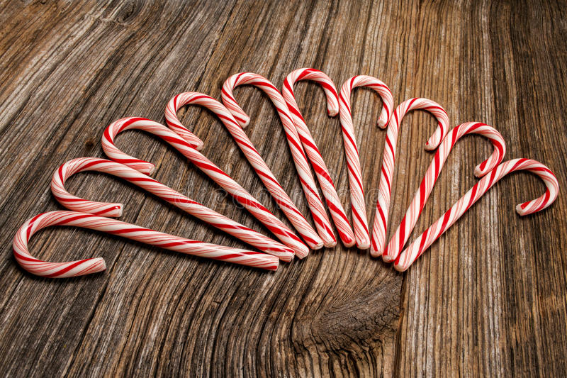 Candy canes,barnwood,background stock photo