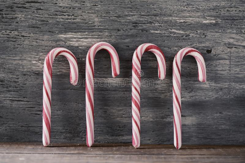Candy canes on a rustic wooden background royalty free stock image