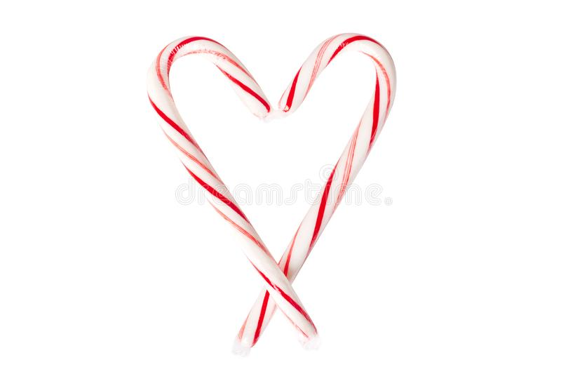 Candy Canes Shaped Into A Heart. Isolated on white stock photography