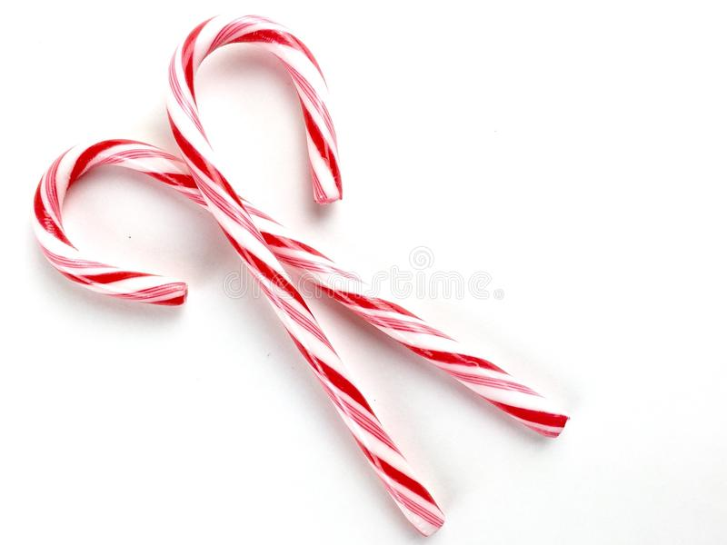 Candy canes. On a white surface royalty free stock image