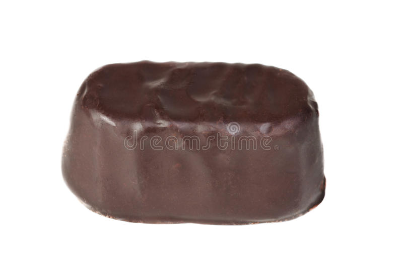 Candy in a chocolate on a white royalty free stock images