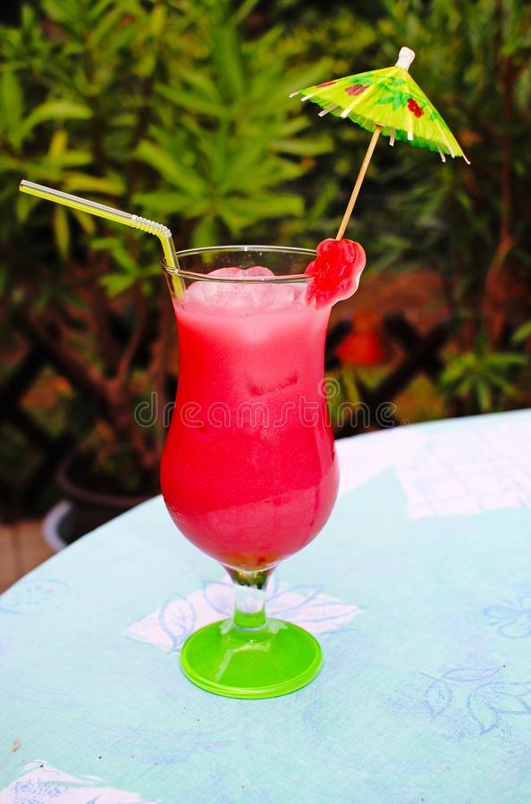 Candy cocktail pink fruity fruit alcohol drink outdoor royalty free stock images