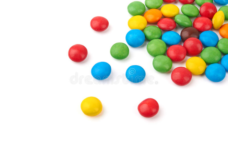Candy. Colorful chocolate buttons on a white background stock image