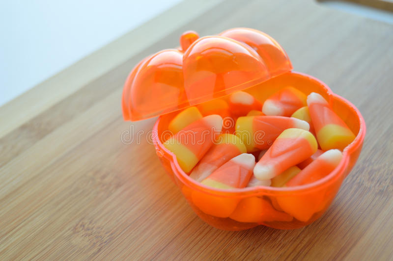 Candy corn in a candy dish stock photo