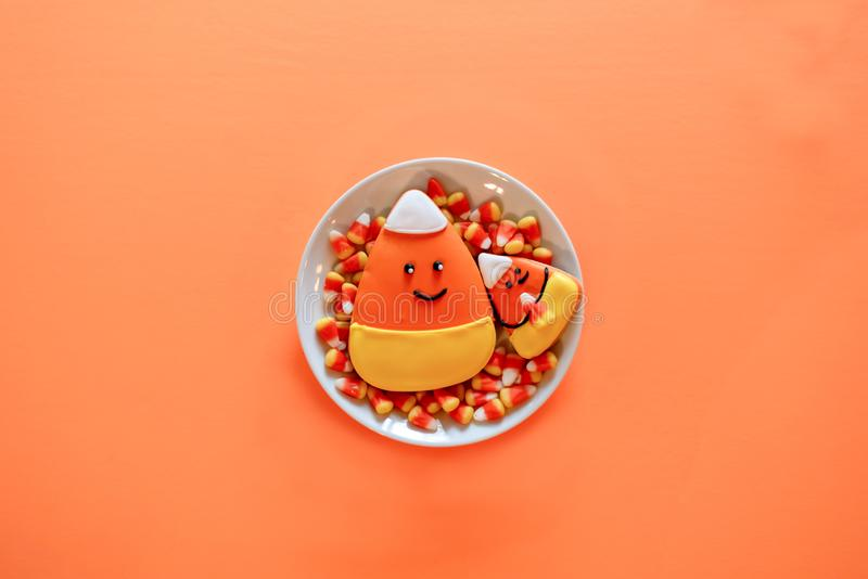 Candy corn cookies on a white plate - Halloween treats stock photo