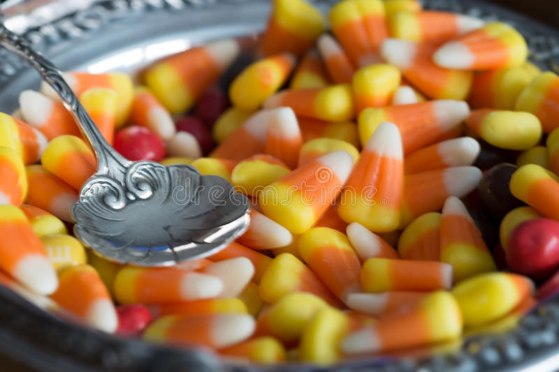 Candy Corn display For Halloween. Halloween candy corn in a silver bowl royalty free stock photos