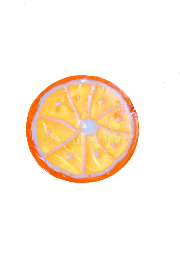 Candy fruit slice. Colorful candy in the shape of an orange slice stock photo