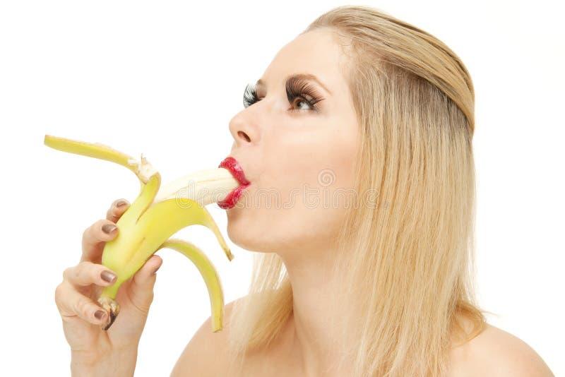 Candy girl sucking a banana