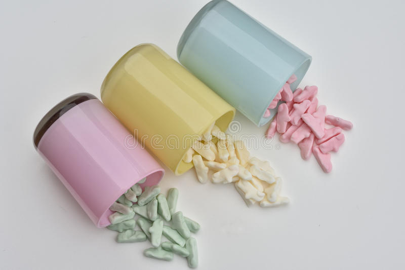 Candy. Glasbowles with candycars in the pastell colours royalty free stock photo