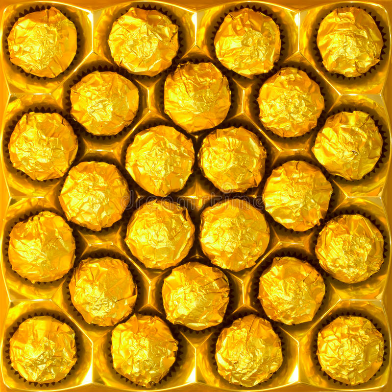 Candy In Gold Wrappers Stock Photos