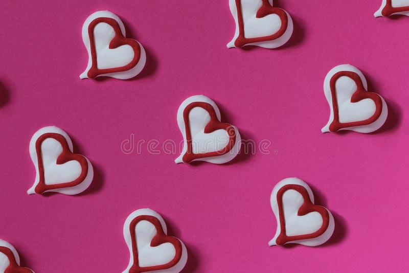 Candy heart white on a pink paper background. Creative conc. Ept. Abstract photo. Template. Top view stock photo