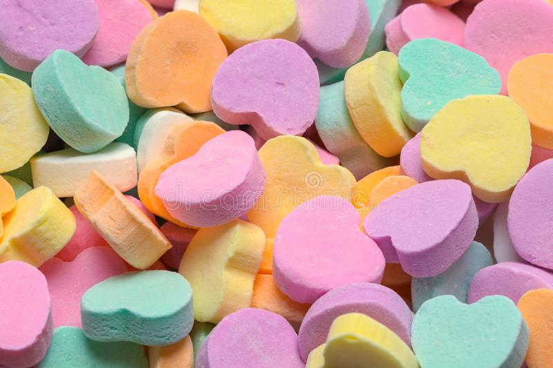 Candy Hearts Background. Pile of Pastle Valentines Hearts Candy Background stock photos