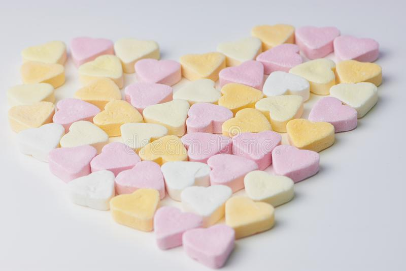 Candy hearts in pastel color, heart shape royalty free stock photos