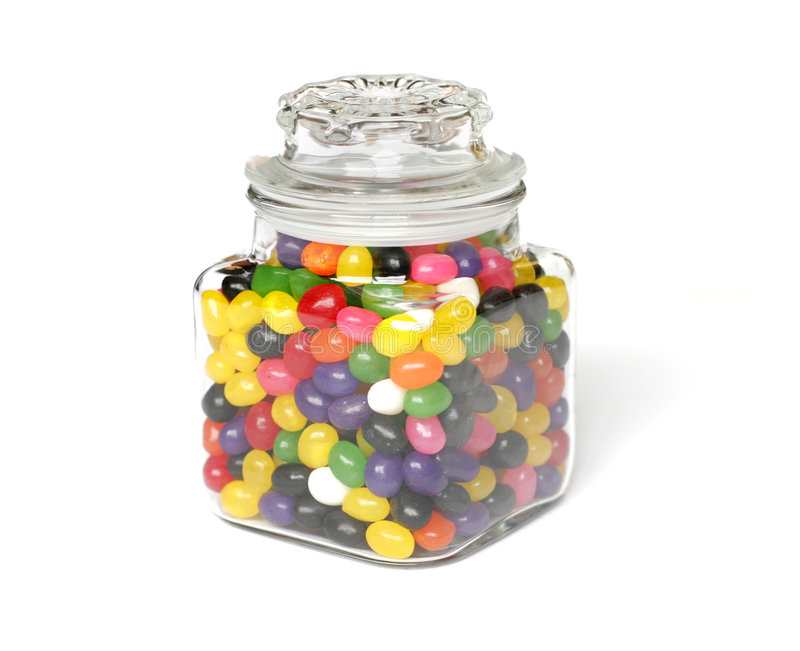 Candy Jar. A glass jar full of candies isolated on white