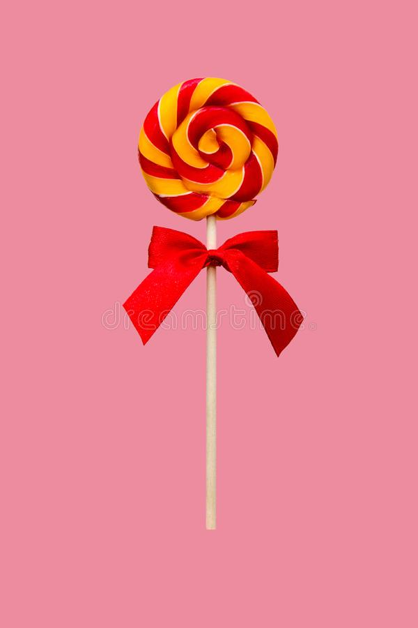 Candy Lollipop, round shape and colorful swirls. Festive sweets for children on pink background. stock illustration