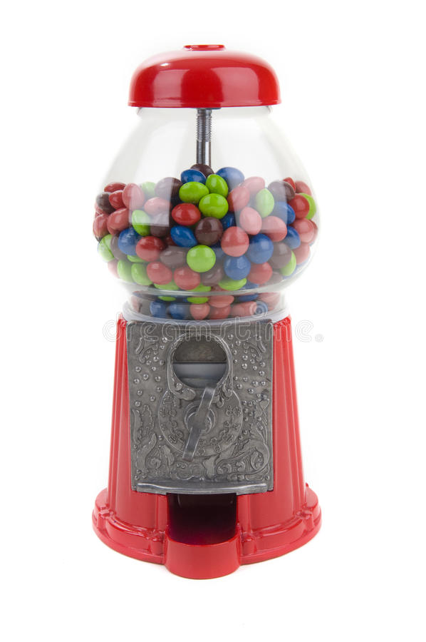 Candy Machine. Vintage coin operated candy machine on a white background royalty free stock photos