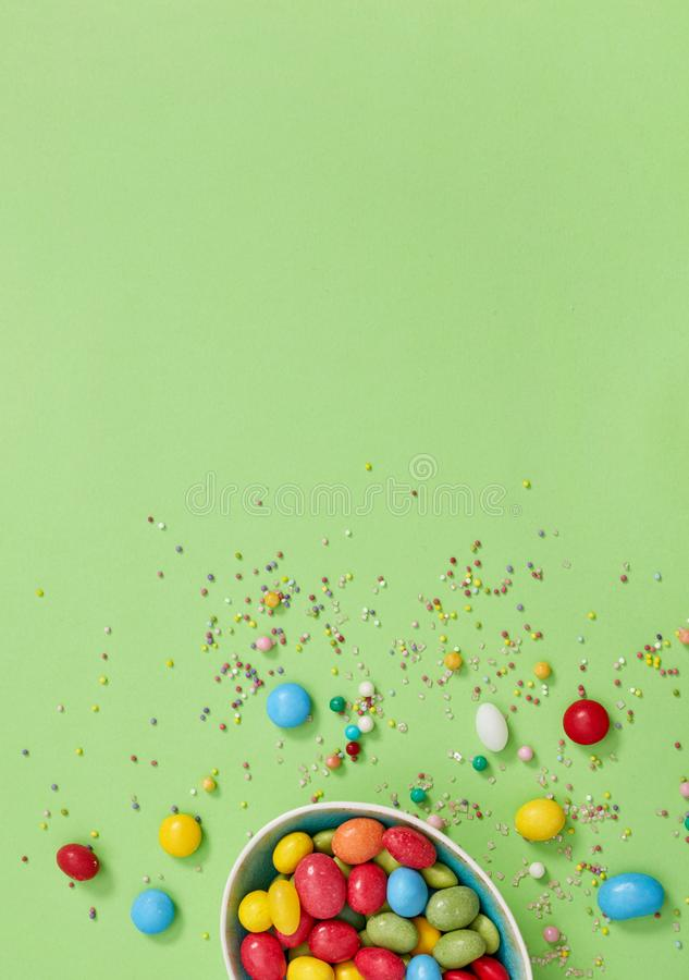 Candy pills spilled on green stock image