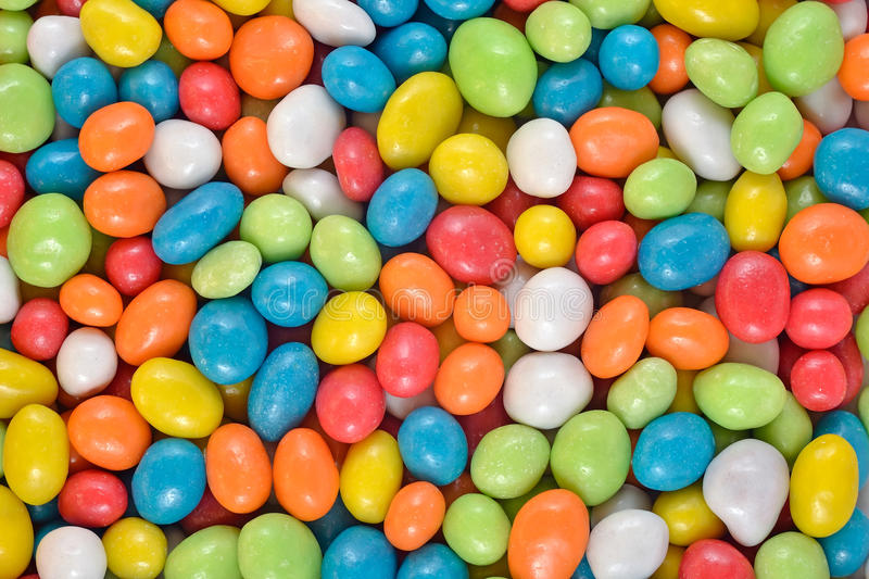 Candy sea pebbles background. Candy sea pebbles as background texture royalty free stock image