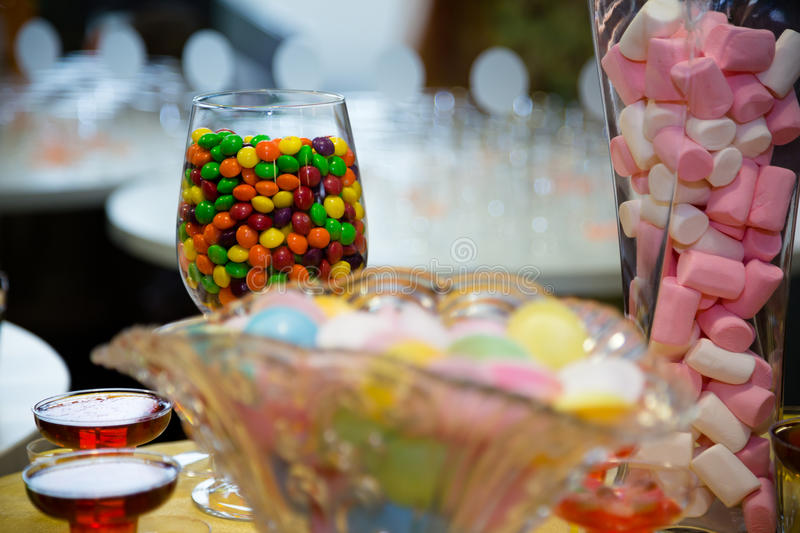 Candy. Sweets in a jar at a party stock photos