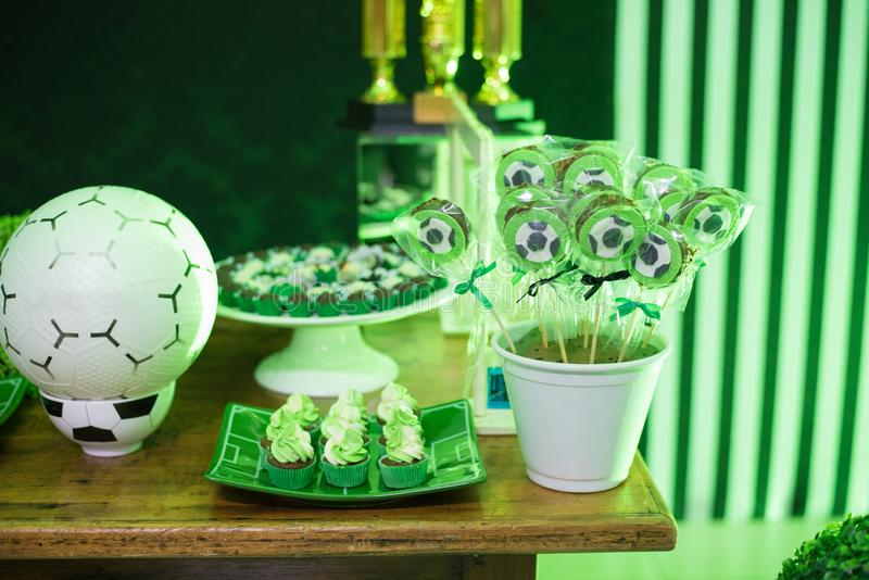 Candy table, chocolate lollipops, brigadier, cupcakes and toy ball stock photo