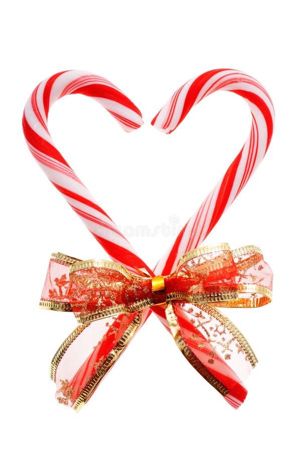 Candycanes con l'arco rosso (isolato) immagine stock