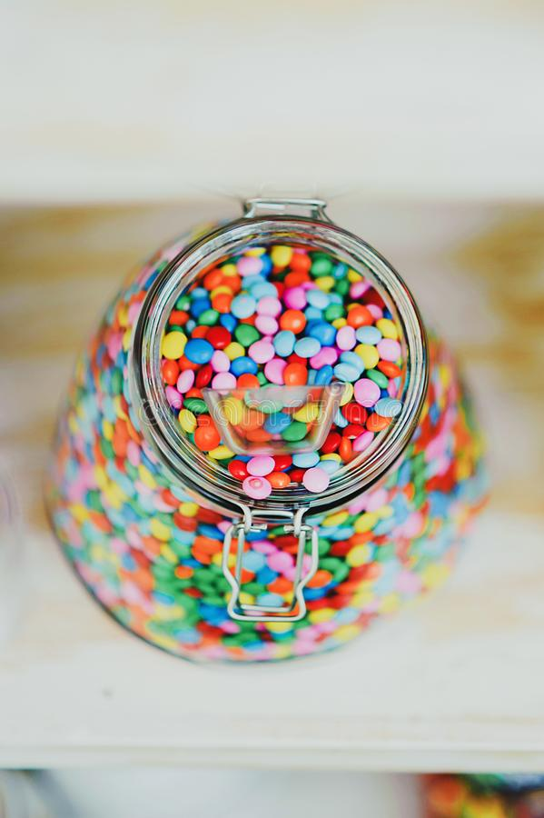 Candys M & M`s dispenser with them, all colours sweet stock images