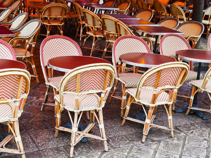 Cane-chairs in paris cafe royalty free stock photo