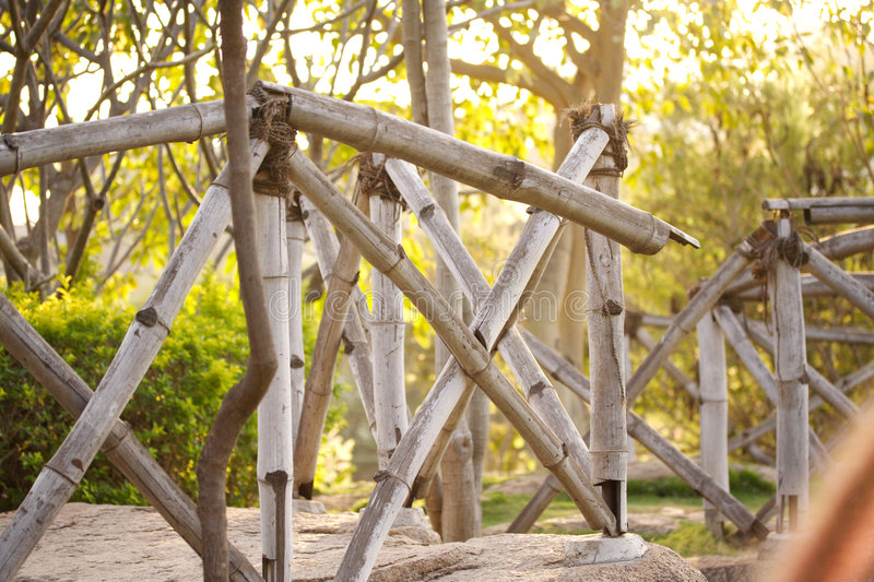 Cane fence. Bamboo made fence on a rock stock photo