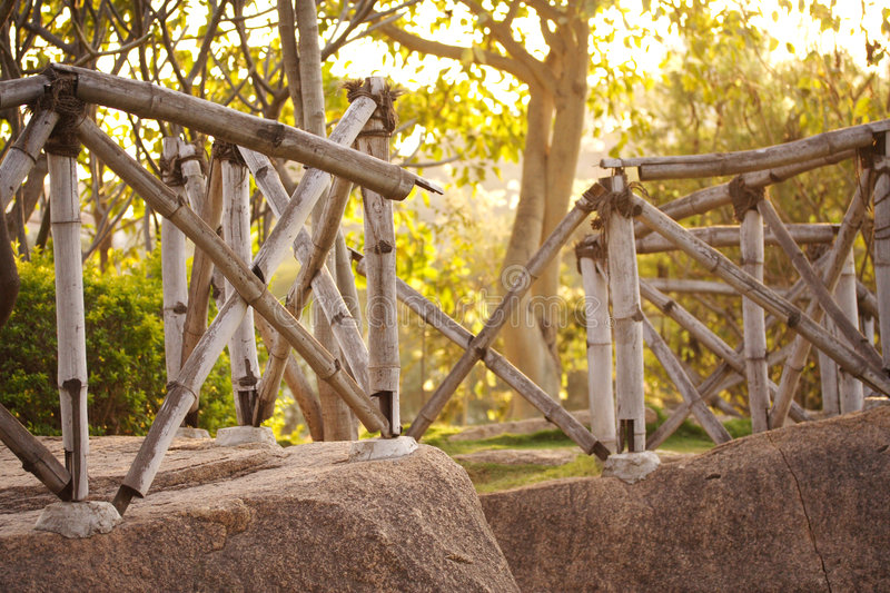 Cane fence. Bamboo made fence on a rock royalty free stock photo