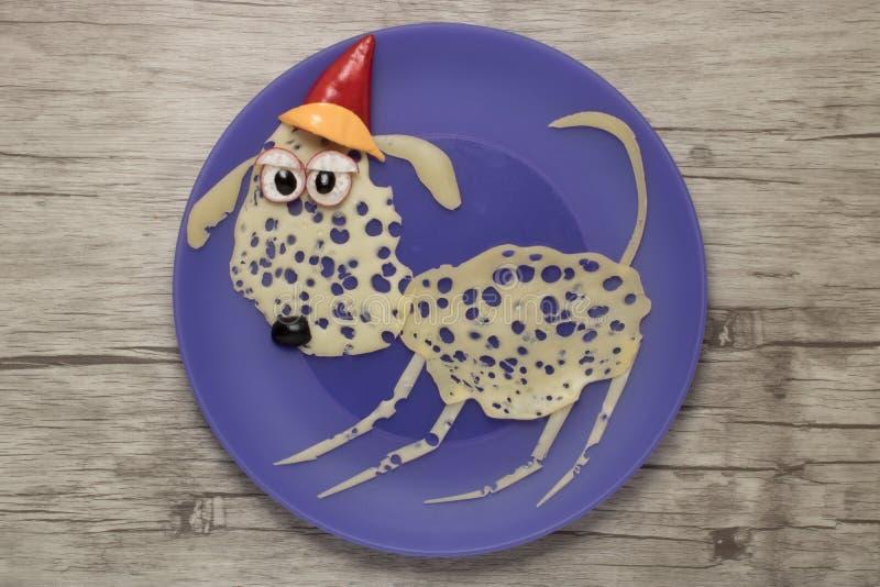 Cane festivo fatto con formaggio per il Natale fotografie stock libere da diritti