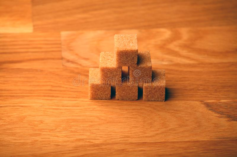 Cane sugar blocks wooden table stock photography