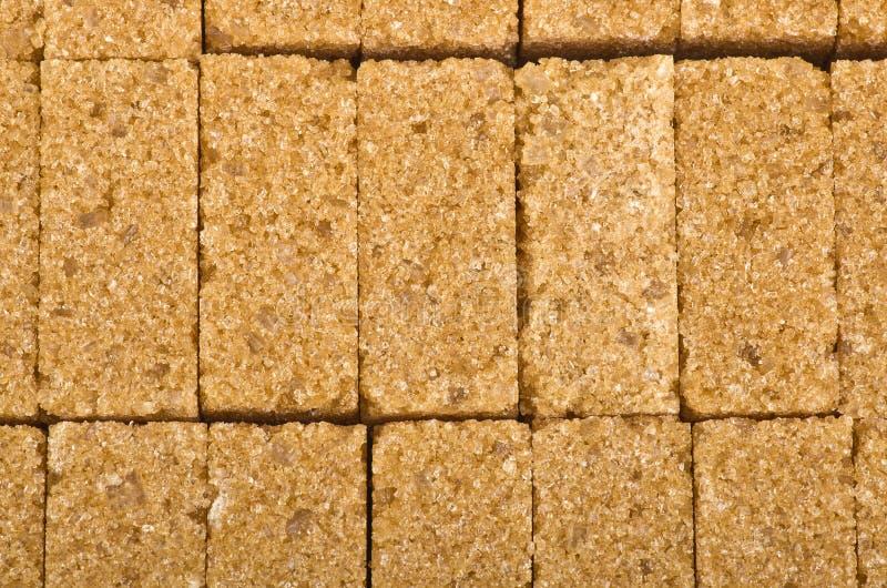 Cane sugar cubes. Brown lump cane sugar cubes close up royalty free stock images