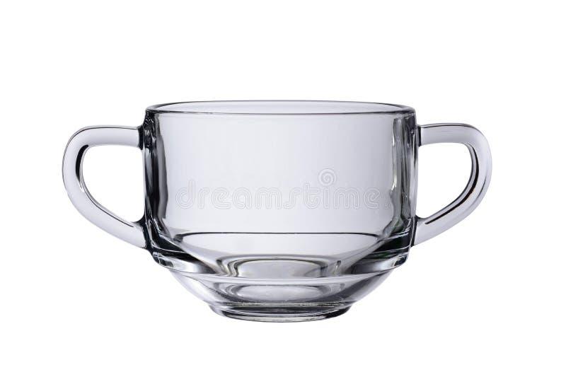 Caneca de vidro vazia com os dois punhos para as sopas ou os caldos isoladas em um fundo branco imagem de stock
