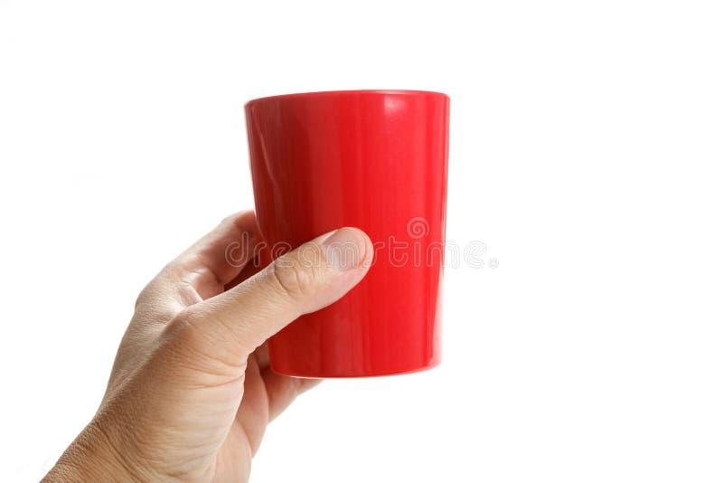 Caneca plástica vermelha imagens de stock royalty free