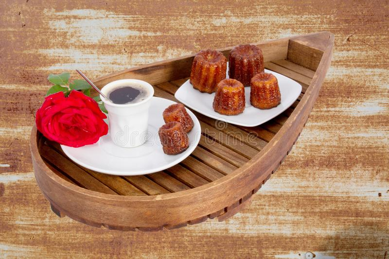 Canele is small Bordeaux French pastry flavored with rum and vanilla with soft and tender custard center and dark thick stock images