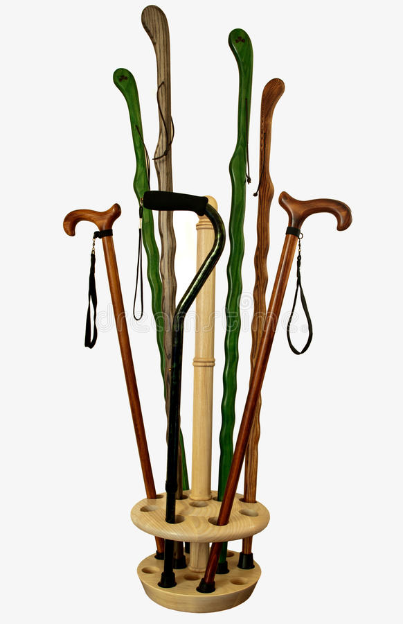 Canes and walking sticks. Wooden canes and walking sticks royalty free stock images