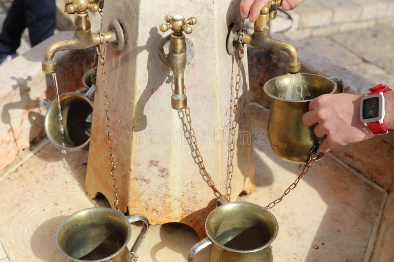 Canes with water beside the Western Wall in Jerusalem. Israel stock photos