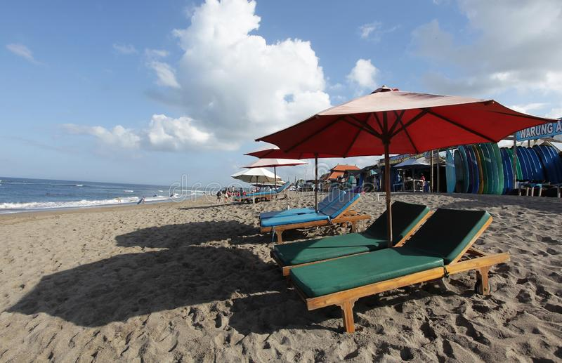Canggu, Indonesia - May 27, 2019: Surfer beach and local shops of surf board rental waiting customer coming to rent during the day royalty free stock images