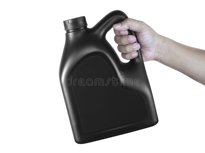 A canister with engine oil in a hand isolated on white background royalty free stock images