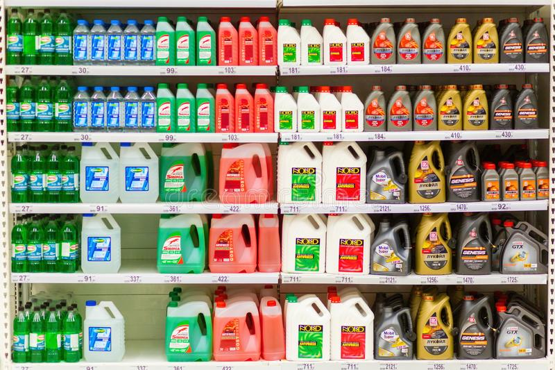 Canisters with motor oils and fluids on store shelves. Russia, Samara, April 2019: Canisters with motor oils and fluids on store shelves. Text in Russian: Lukoil stock image