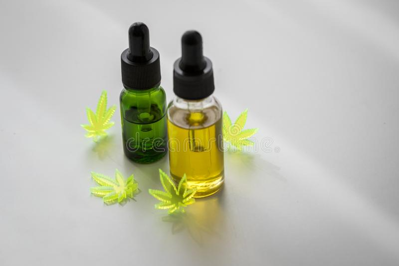 Cannabis marijuana hemp CBD oil as pain killer and medical therapy stock photography