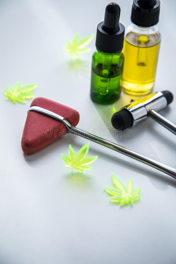 Cannabis marijuana hemp CBD oil as pain killer or medical therapy for multiple scleroses, Parkinson, depression, spasticity at. Neurologist doctors office with stock photography