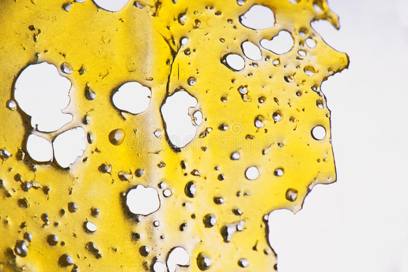 Cannabis oil concentrate aka shatter isolated stock images