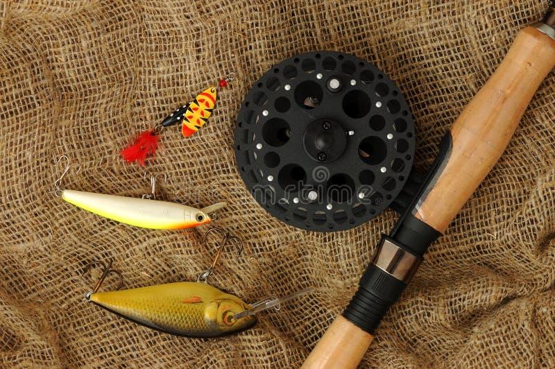 Canne à pêche avec des accessoires images stock