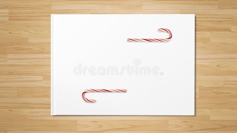 Canne de sucrerie rouge de Noël sur la table en bois photo libre de droits